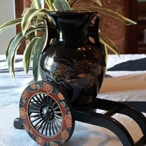 An Oriental vase.